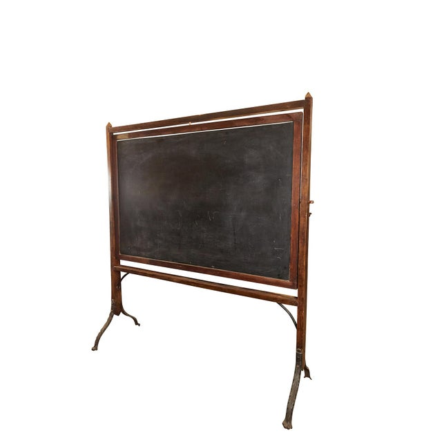 This exceptional blackboard has beautiful wood and cast iron design and construction. The blackboard itself does not...