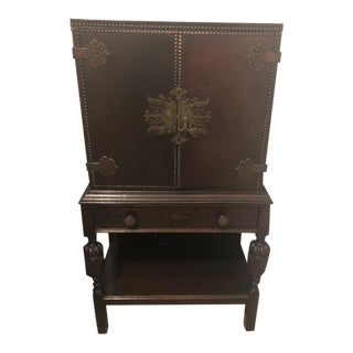 1920s Jacobean Brass Mounted Cabinet Oak With Leather Top For Sale