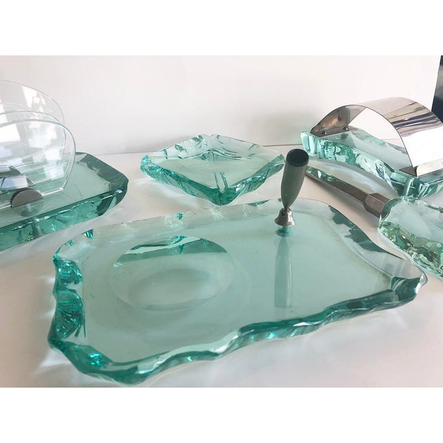 Vintage mid-century modern desk set by Fontana Arte. Hand chiseled crystal. Five piece set includes a letter file, pen...