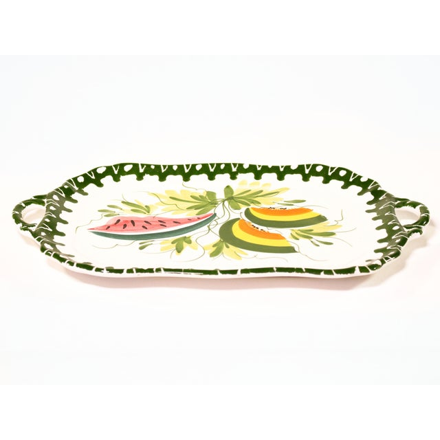 Hand-painted Italian cartouche shaped terra cotta handled tray with brightly colored melon slices, foliage and dark green...