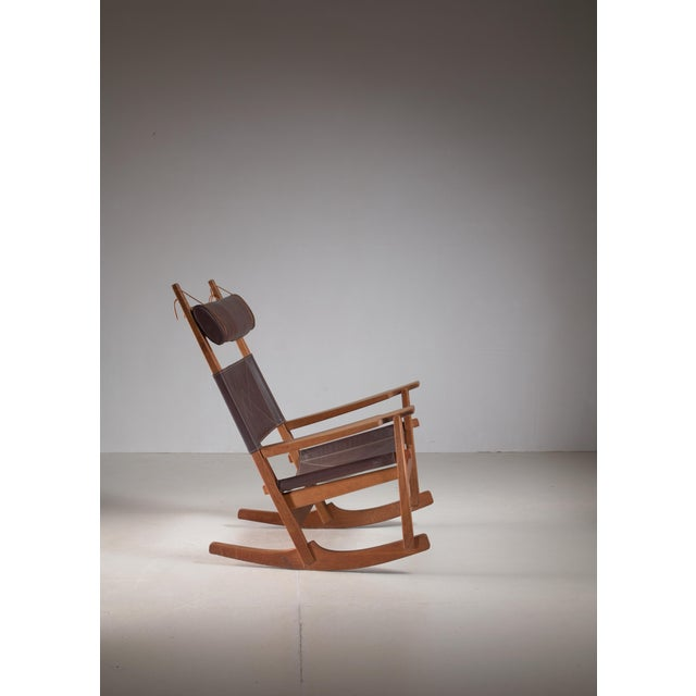 Key hole rocking chair by Hans Wegner, Denmark, 1960s. Oak base with wonderful warm patina and original brown leather...