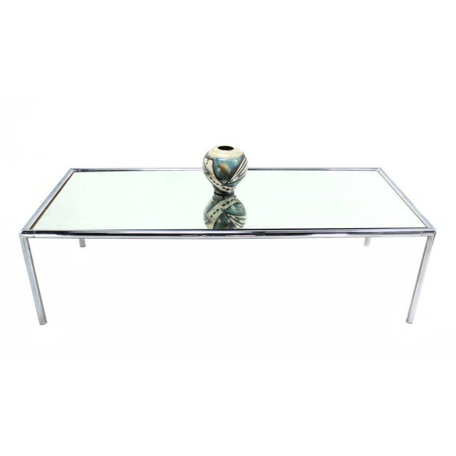 """Chrome tube frame design 98"""" long table with mirror glass top. Excellent display table. John Mascheroni."""