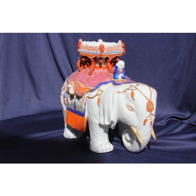 Late 19th century or early 20th century piece. This is a porcelain Elephant and Stupa possibly Japanese.