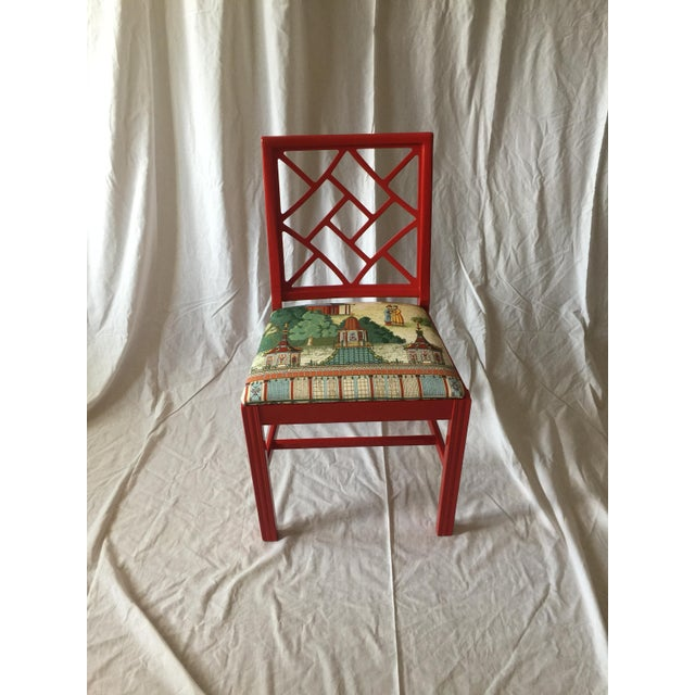 Red lacquered chair with cushion covered in designer Manuel Canovas fabric. An incredible showstopper that would look...