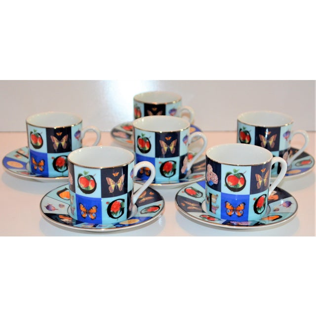 This is a set of 6 Gucci demitasse / expresso cups and saucers in the Guccissimo china pattern . These are from the 1990s...