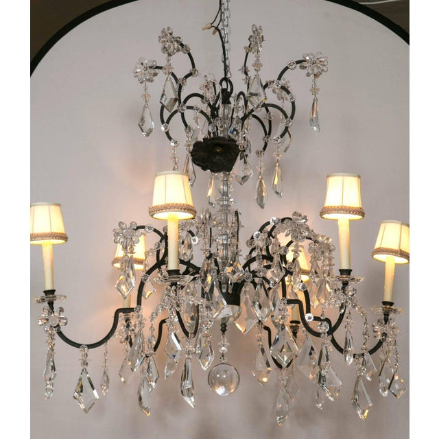 A Holly Hunt wrought iron and crystal scroll form chandelier. From a spectacular home on the North Shore of Long Island...
