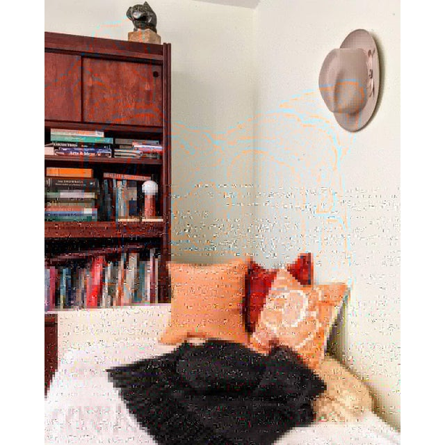 Modernist embroidered white cotton pillow with vivid orange floral abstract pattern. Mixes well with modern, boho and...