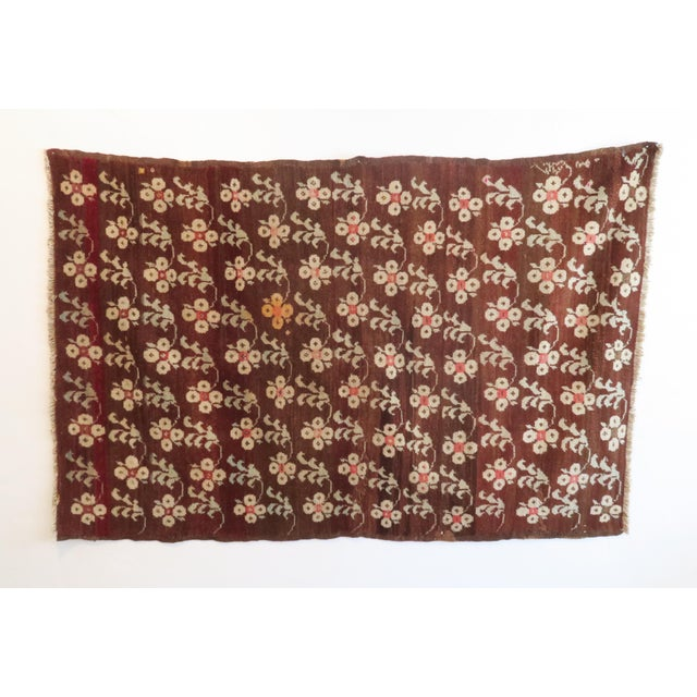 Beautiful vintage hand woven Turkish rug. Estimated to be 70 years old. All over floral design and gradation from deep...