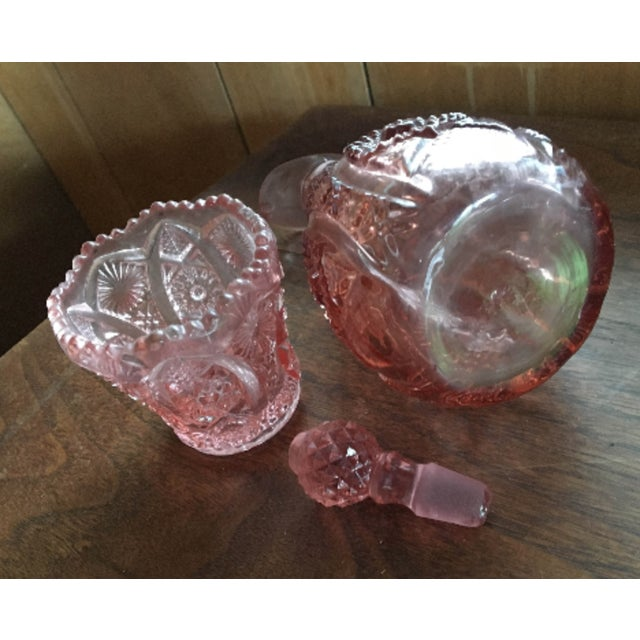Vintage L E Smith moon and stars pattern glass oil cruet with drinking cup in excellent condition 434 grams, 15 oz. The...