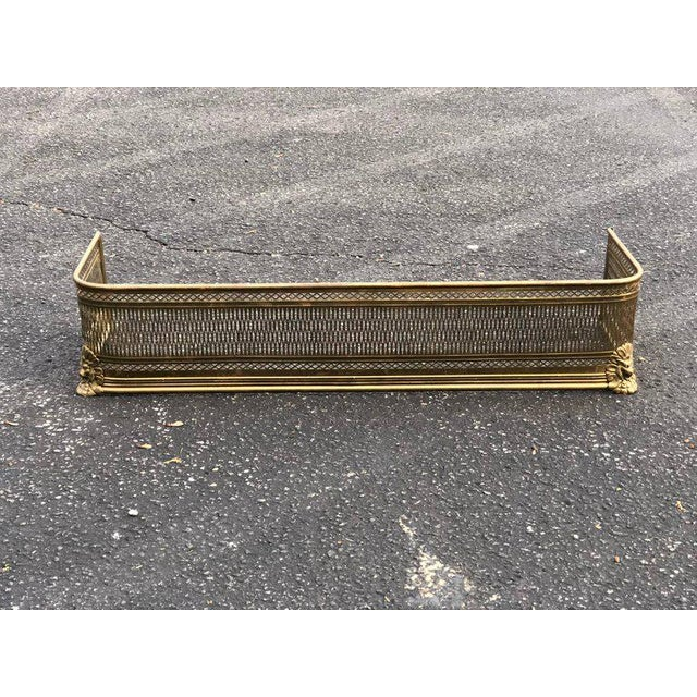 Pierced Brass Fireplace Fender with Lions. Perfect decoration around your fireplace. CONDITION Good WEAR Wear consistent...