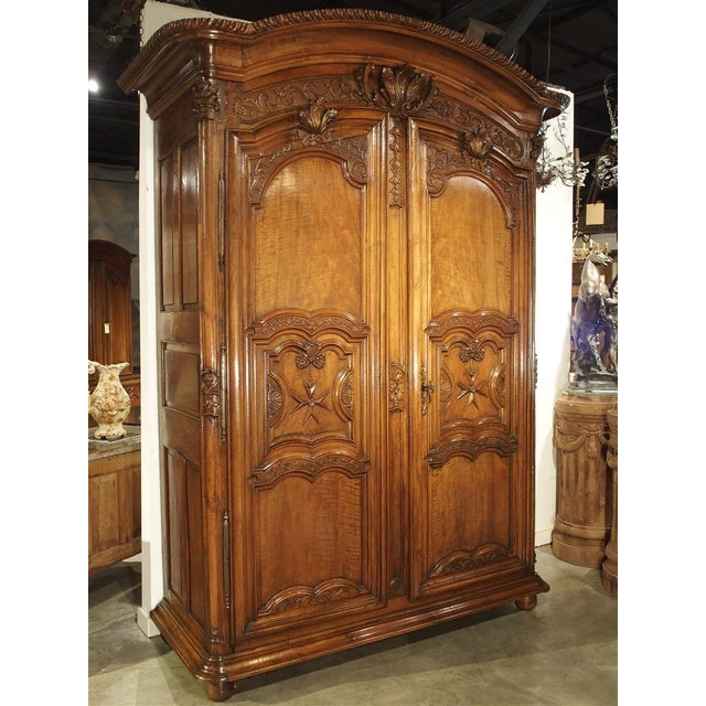 The 'Cross of Saint Louis', carved into the front panels of this armoire represents L'Ordre de Saint Louis. This was an...