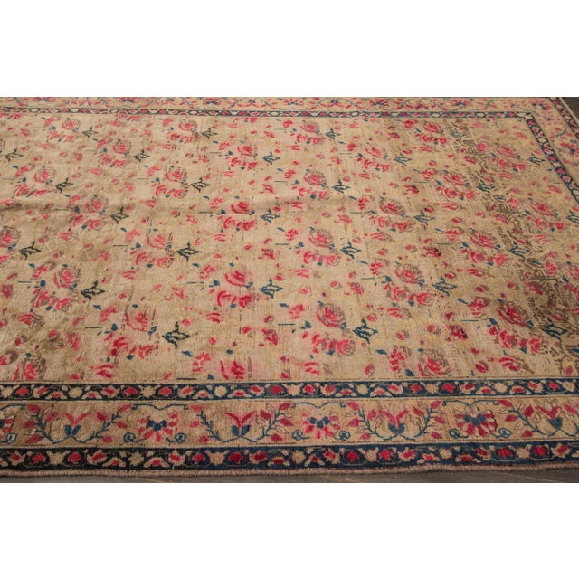 A hand-knotted Basserabian style Rug with an allover floral design. This piece has magnificent detailing and would be the...