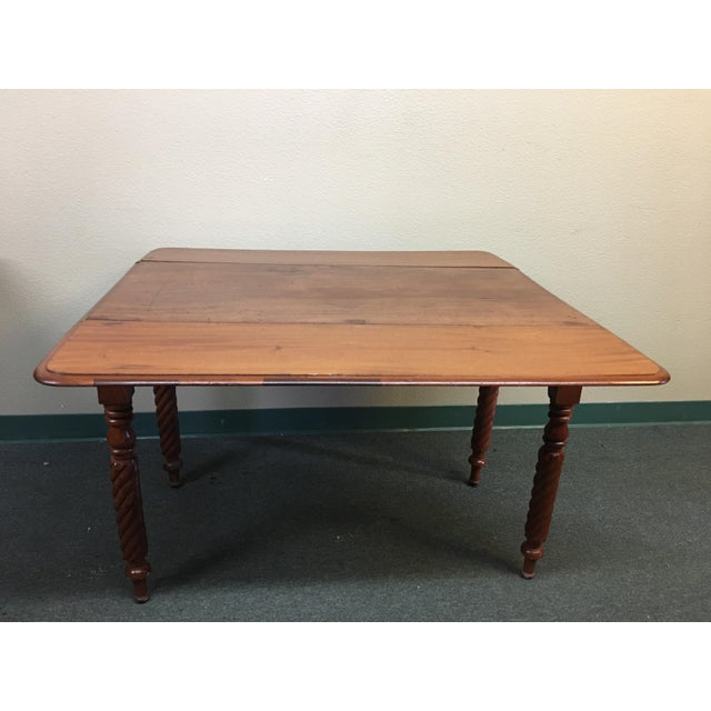 Design plus Gallery has a small vintage drop leaf table. This petite table would be ideal for a small space. When fully...