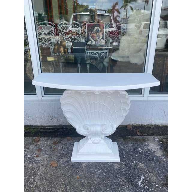 Refinished Grosfeld House plaster shell console table. Wooden frame with shell shaped mid section. Circa 1950's.