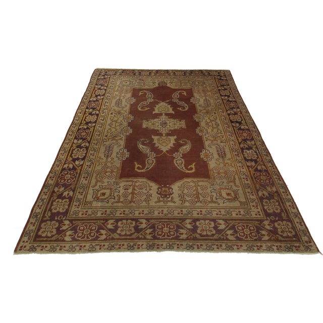 Hand Knotted Wool Turkish Rug. Floral design. Measures 4′ × 5′6″.