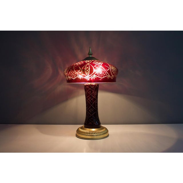 Red glass table lamps with brass base, France, 1950s. Very good original condition.
