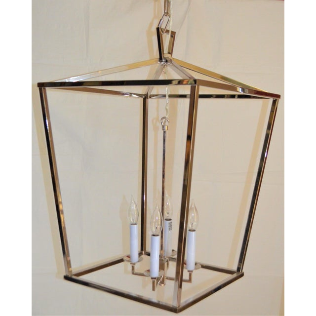 """This is a Visual Comfort Darlana Lantern in a Polished Nickel finish. This is the medium lantern measuring Width 17"""",..."""