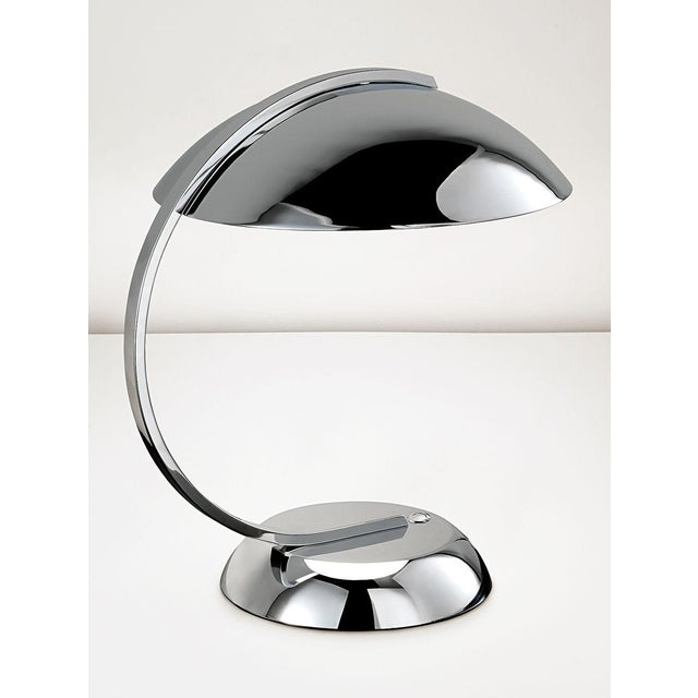 Polished chrome desk light with an integral LED light source. Colour co-ordinated push button switch in the base. Opal...