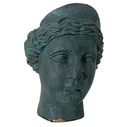 A female bust made of brass sits inside a leaded glass and marble display box.Heavy application of green patina.