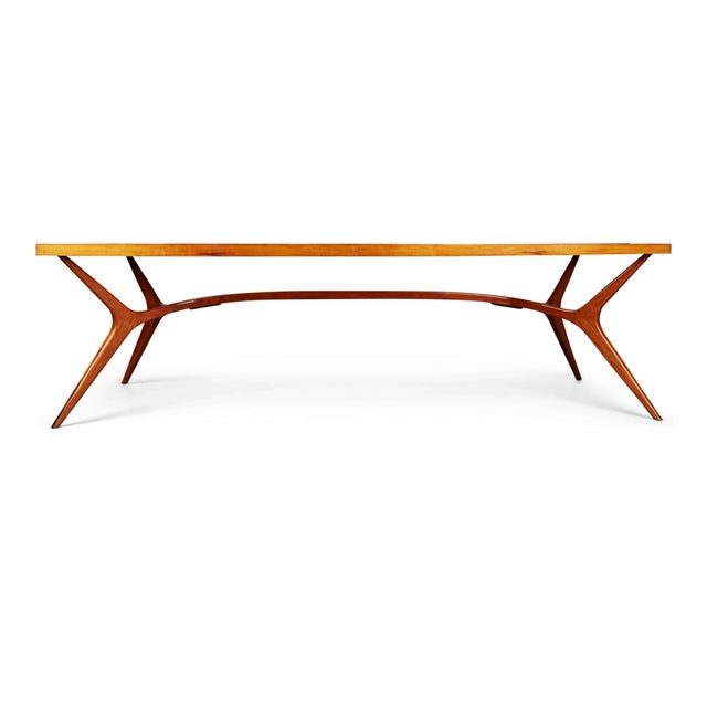 Recently imported from a private collector in Brazil, this extraordinary dining table embodies the use of curvaceous lines...