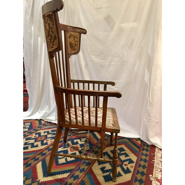 I love how unusual the form of this chair is. Constructed of walnut with hints of the American windsor chair in its style,...