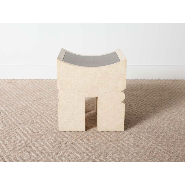 African style stool. Faux ivory shagreen base with faux bronze ostrich insert in top. Pair available.