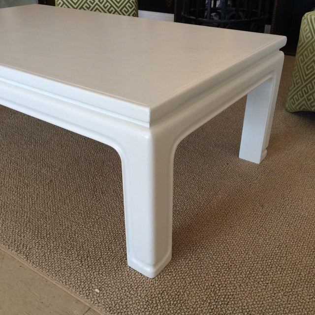 Sophisticated coffee table in the style of Karl Springer. Painted wood with a linen wrapped texture.