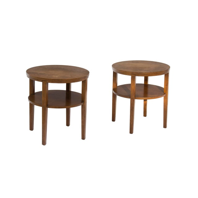 Round combed oak end tables made by Grand Rapids Bookcase & Chair. These are stamped 'Oakmasters Modern' and 'Chamois...