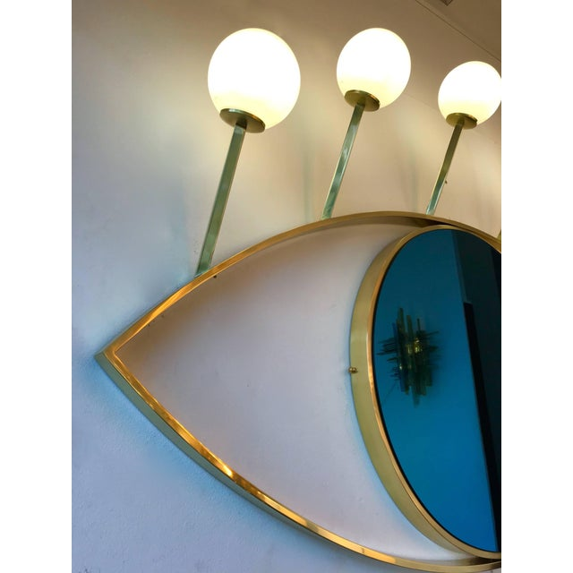 Blue eyes full brass lightning mirror with sconces. Opaline glass ball. Few exclusive production on order from a small...