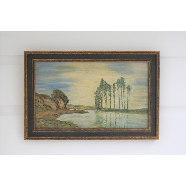 This lovely fauvist landscape painting was done in oil on board in the 1930s and depicts a village scene near a body of...