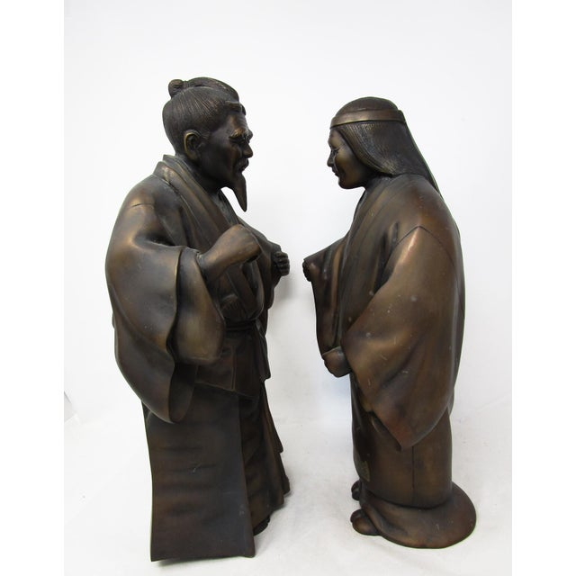 Bronze Figures - Man and Woman Farmers or Peasants Here are two bronzes statues of a pair of Japanese farmers or peasants....