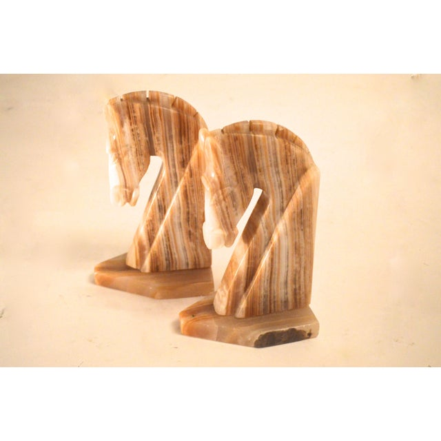 A stately pair of solid Onyx Mid-Century bookends in the shape of a Trojan horse head. In pristine vintage condition,...