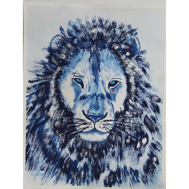 A wild lion portrait with sky blue eyes in shades of indigo blue, inspired by blue and white Chinese paintings....