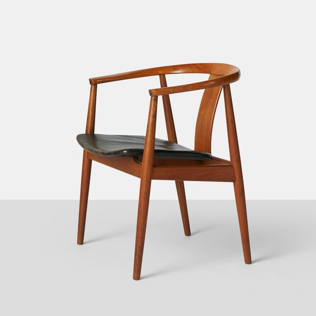 A very comfortable guest chair in teak with a black leather seat. Manufactured by Gustav Bertelsen, Copenhagen. Seat shows...