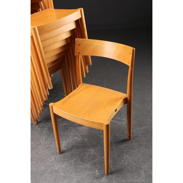 This model Portex stackable dining chair was designed in 1945 by Peter Hvidt and Orla Mølgaard-Nielsen, and was produced...