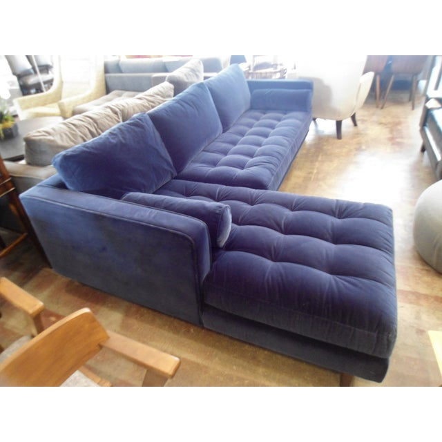 This is a beautiful velvet sofa with tufted seating and down filling. It comes apart into two pieces, and the round...