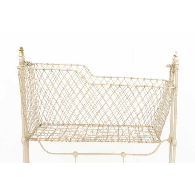 Rare 19th century Victorian painted wrought wire and cast iron child's swinging cradle. Each end is accented with three...