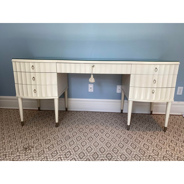 Barbara Barry's iconic ladies desk in cream colored lacquer. Beautiful scallop detail with polished nickel oval pulls....