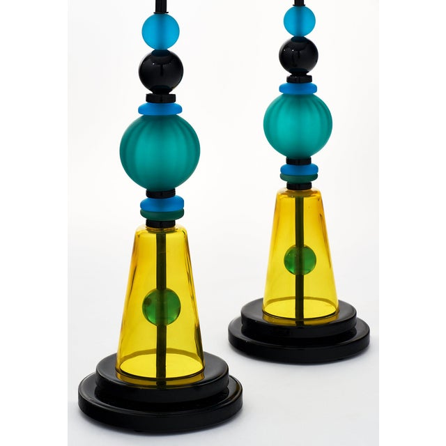 A pair of hand-blown Murano glass geometric lamps featuring unique glass components in blues and yellow. We love the bring...