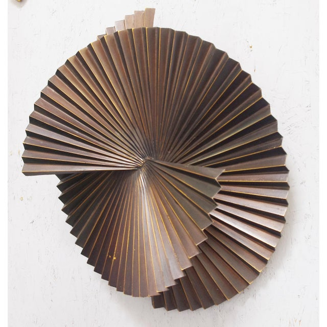 Limited edition large dark bronzed metal sconce or wall sculpture in spiral fan design / Designed by Fabio Bergomi for...