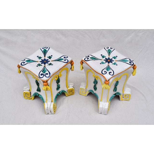 A pair of vibrantly painted & glazed terra-cotta garden stools with faux tassel cushions & greek key motif base. Each is...