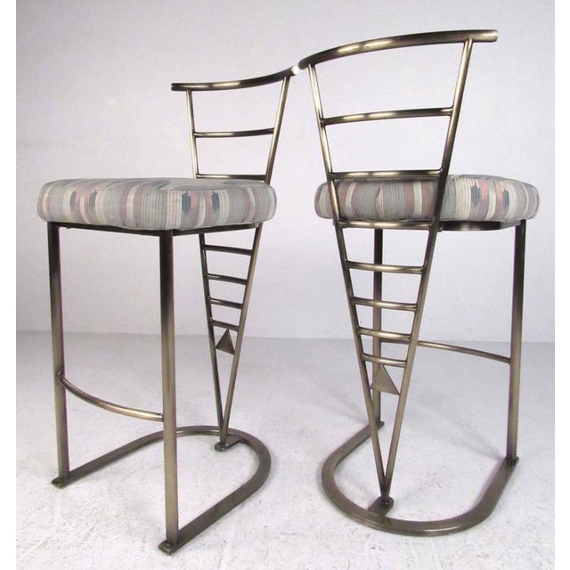 This stylish pair of bar stools by Design Institute of America feature sturdy metal frames with plush upholstered seats....