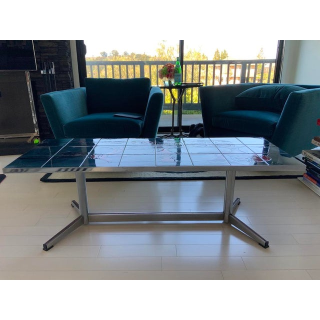 Beautifully crafted chrome and ceramic tile coffee table, circa 1960, Italy. This cocktail table features an eye catching...