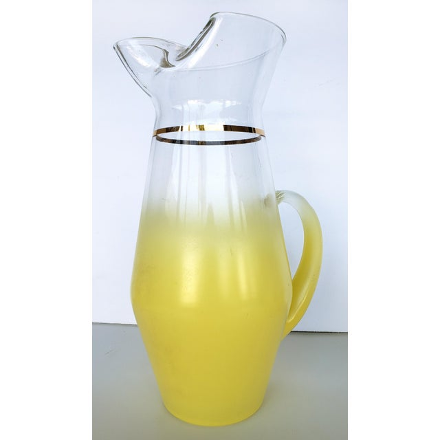 Offered for sale is a Mid-century Modern Blendo 5-piece Pitcher and glasses Set. The gasses and pitcher each have frosted...
