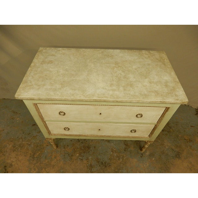Italian Louis XVI style painted two drawer commode with faux marble top.