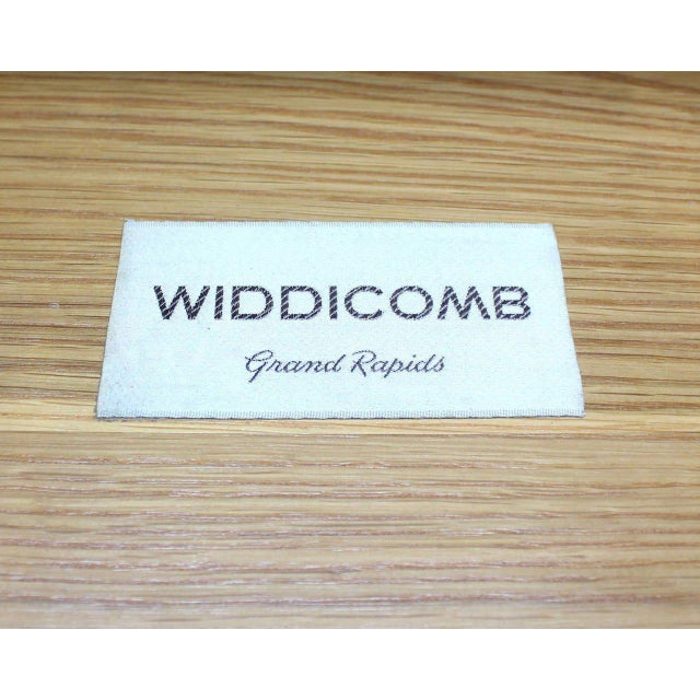 Very nice mid century modern dresser designed by Robsjohn-Gibbings for Widdicomb. Nice curved long silver bullet shape...