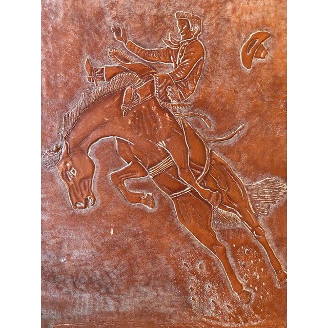 Leather Tooled Cowboy Plaque that is wood backed for a great southwestern look!