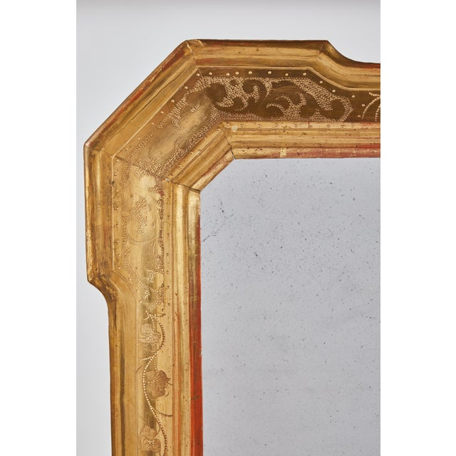 An 18th century mirror with hammered detailing from Lombardy. Petite rectangular frame with angles corners. Very sweet...