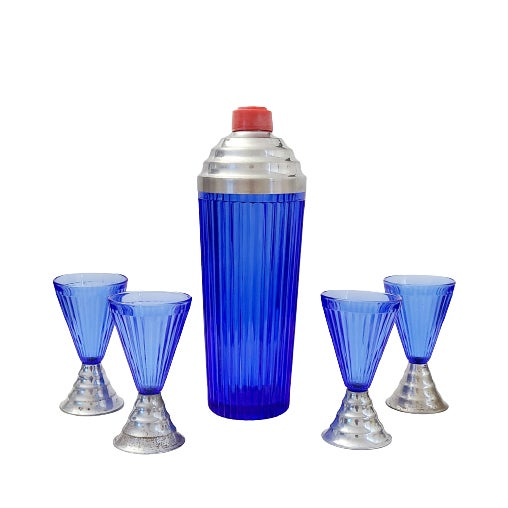 Gorgeous Art Deco cocktail set in rich cobalt blue, with elegant ribbed glass sides. Heavy ribbed glass cocktail shaker...