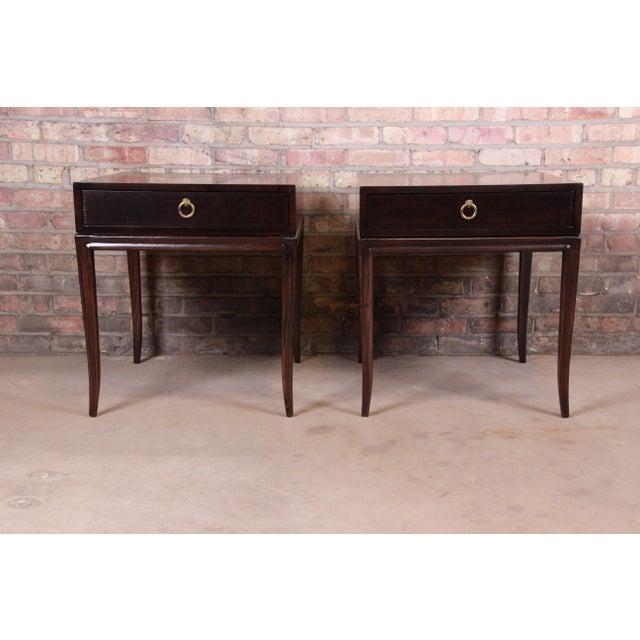 An elegant pair of Robsjohn-Gibbings style mid-century modern Hollywood Regency nightstands or end tables By Drexel...